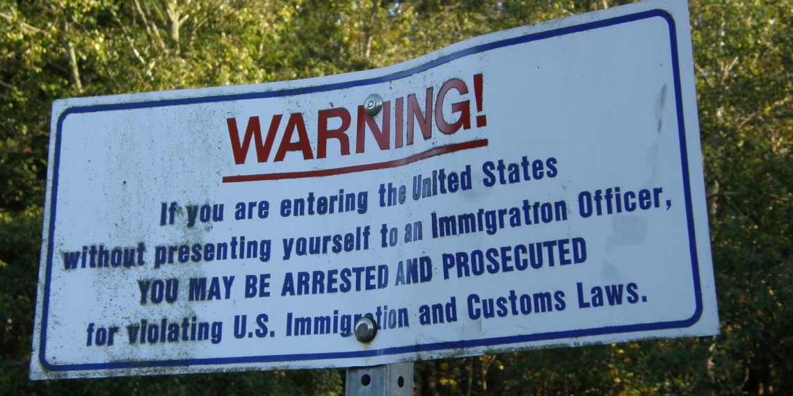 Warning sign on border